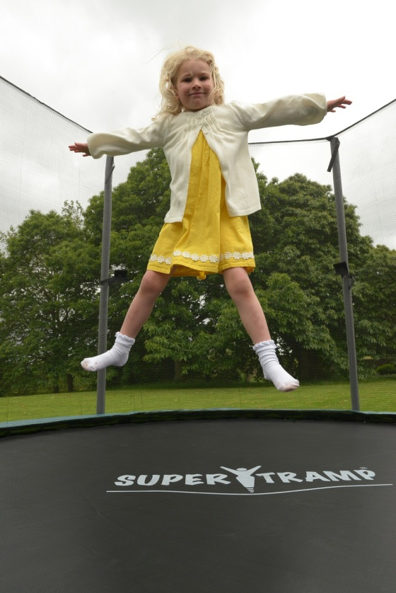 Four-year-old Millie Fisher bouncing on a Super Tramp trampoline.