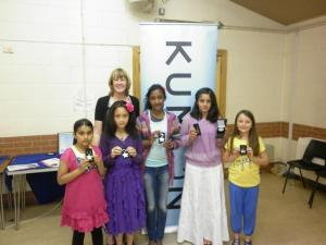 Kumon students receiving achievement awards at a recent ceremony