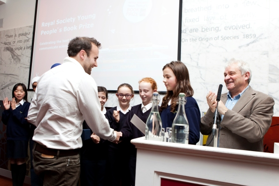 © The Royal Society Winning author Rob Lloyd Jones collecting the 2013 Royal Society Young People's Book Prize at last year's award ceremony.
